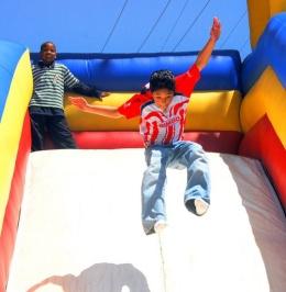 Boys On Blow-up Slide